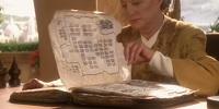 Kai Winn lee un libro bayoraño antiguo